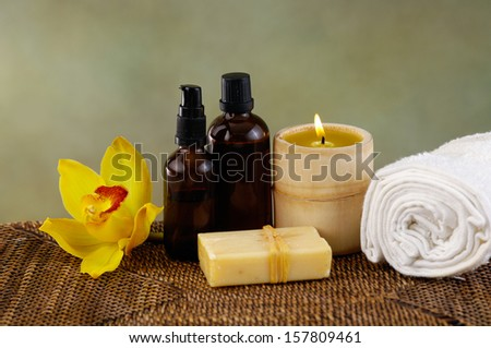 beautiful yellow orchid ,candle, soap ,towelon mat