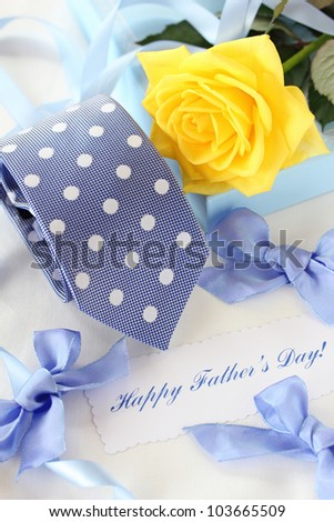 Beautiful yellow rose and tie for father's day - stock photo
