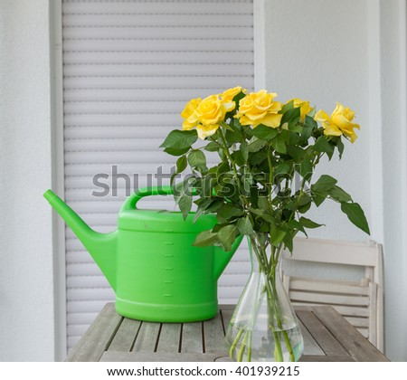 Beautiful yellow roses in a vase on the table