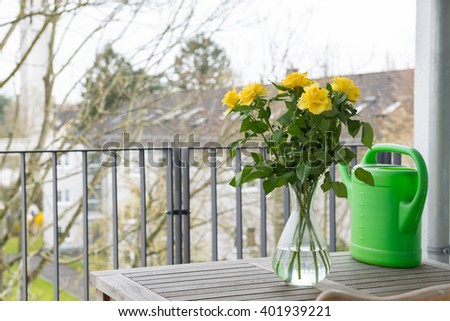 Beautiful yellow roses on a balcony