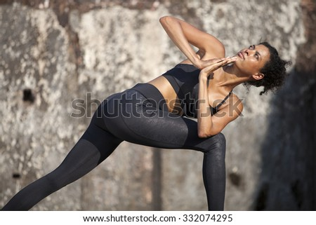 Beautiful yoga position at the ruins of India. - stock photo