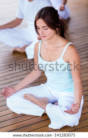 Beautiful yoga woman meditating with eyes closed - stock photo