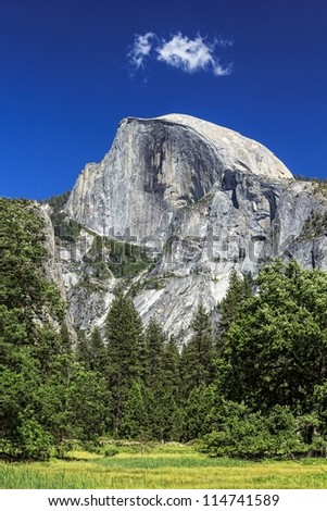 Beautiful Yosemite Valley with Half Dome in the distance - stock photo