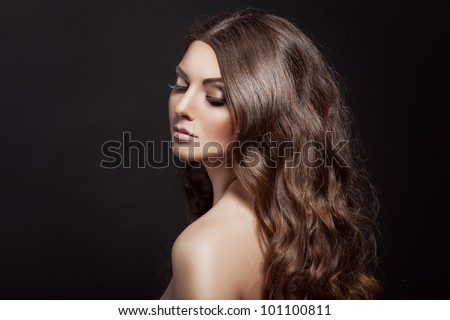 Beautiful young adult girl with long curly beauty hair posing - stock photo