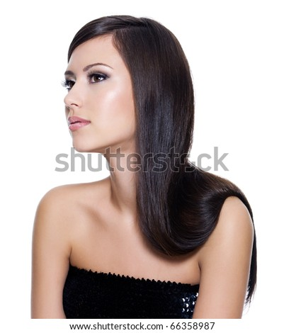 Beautiful young adult girl with long straight beauty hair posing isolated on white background - stock photo