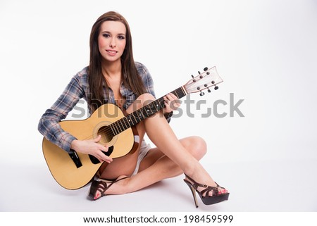 Beautiful Young Adult Woman Modeling on Set for An Album Cover