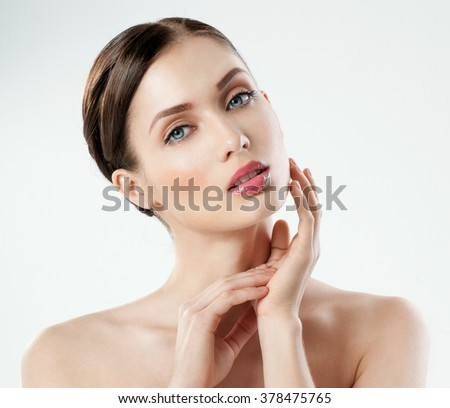 Beautiful  young adult woman with clean fresh skin. - stock photo