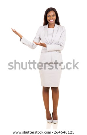 beautiful young african american businesswoman doing welcome gesture on white background - stock photo