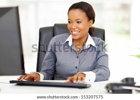 beautiful young african american businesswoman working on computer - stock photo