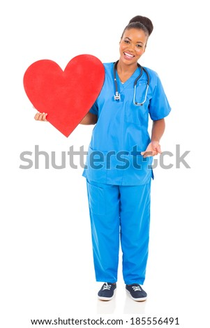beautiful young african american doctor holding heart on white background - stock photo