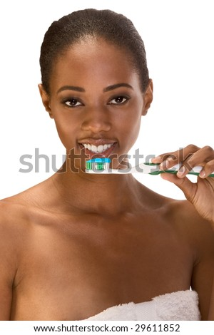 Beautiful young African-American female with Slicked Back Hair with toothbrush and blue toothpaste - stock photo