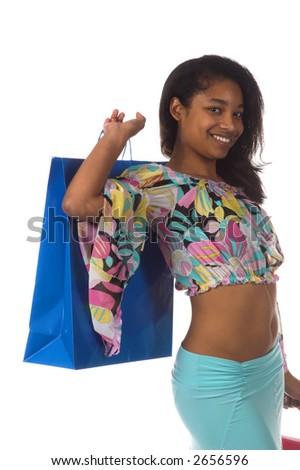 Beautiful young African American girl Holding colorful shopping bags - stock photo