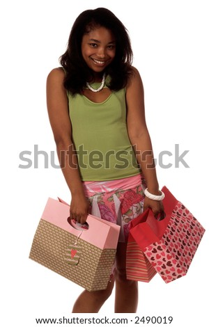 Beautiful young African American girl out shopping for Valentine's Day gifts. Carrying Valentine's Day themed shopping bags