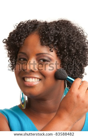 Beautiful Young African American Woman Applying Makeup - stock photo
