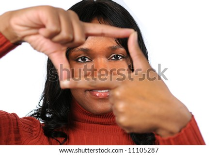 Beautiful young African American woman creating a frame with her fingers - stock photo