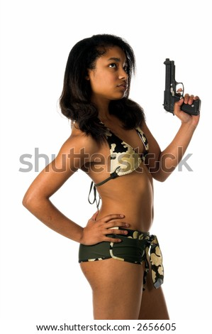 Beautiful young African American woman in a camo bikini poised and ready with a 45 caliber handgun in her left hand - stock photo