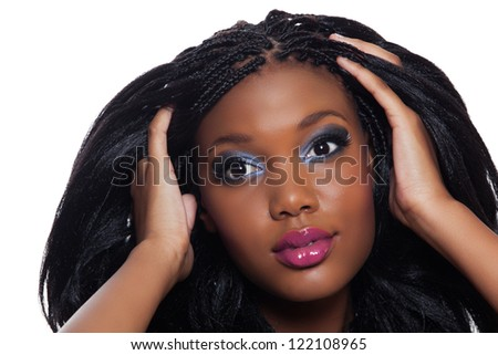 beautiful young African American woman with long black hair and bright makeup