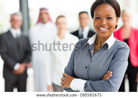 beautiful young african businesswoman and team - stock photo
