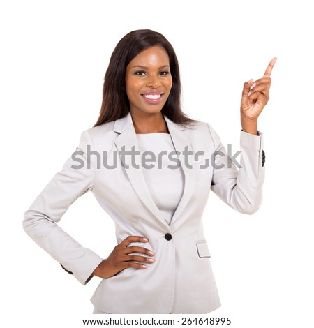 beautiful young african businesswoman pointing up - stock photo