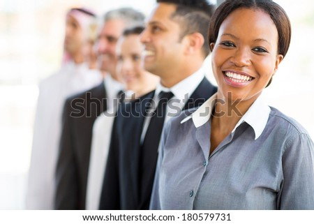 beautiful young african businesswoman with business team - stock photo