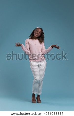 Beautiful young african woman on blue background - stock photo