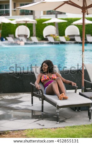 Beautiful young African woman on vacation.
