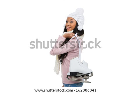 Beautiful young afro-American woman smiling at camera. Having skates over shoulder