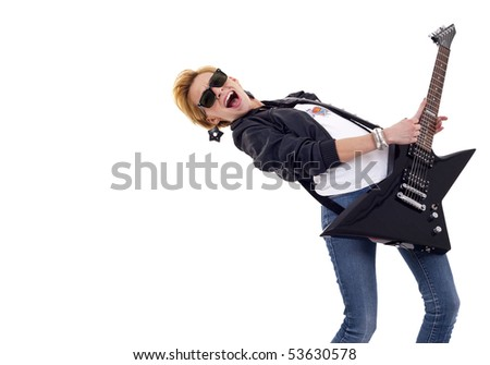 beautiful young and attractive woman playing an electric guitar - with lots of copyspace - stock photo