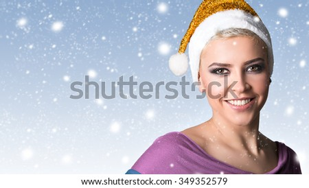 Beautiful young and happy smiling girl with santa hat. Winter concept. New year