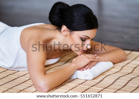 Beautiful, young and healthy woman in spa salon. Spa, health and healing concept.