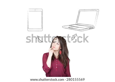 Beautiful young and pretty woman taking a decision (choose) between tablet and notebook (laptop) - isolated on white background - stock photo