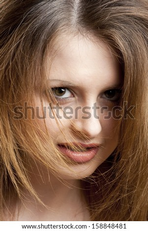 Beautiful young angry woman close up