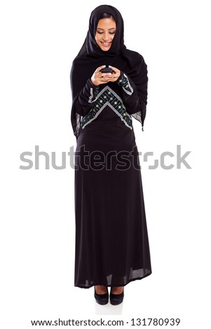 beautiful young arabian reading email on smart phone isolated on white - stock photo