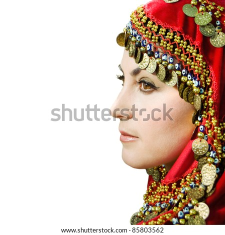 Beautiful young arabian woman in traditional clothing with bridal makeup and jewelry. gorgeous bride traditionally dressed. Isolated on white. Arabian belly dancer. Side view. Close-up portrait - stock photo