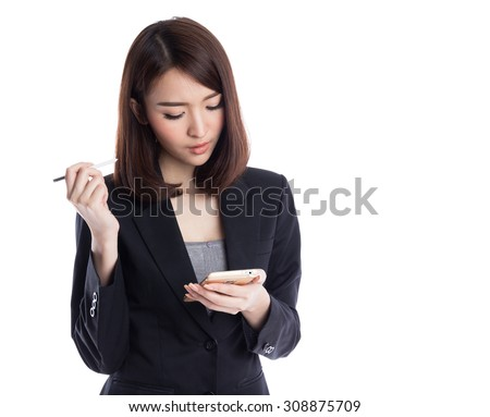 Beautiful young asian business woman typing and thinking with stylus on device or smartphone, isolated on white background - stock photo