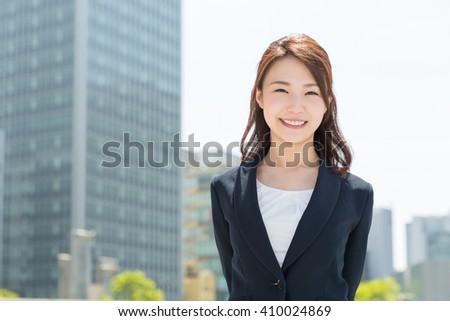 Beautiful young asian businesswoman - stock photo