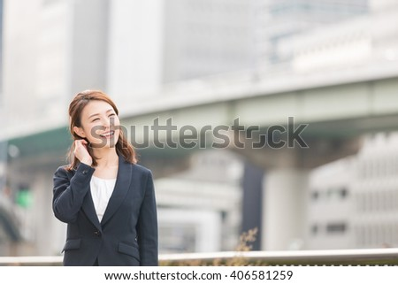 Beautiful young asian businesswoman who smile - stock photo