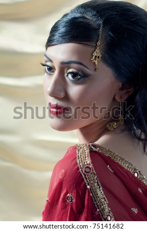 Beautiful young asian/indian woman wearing traditional clothes and jewelry - stock photo