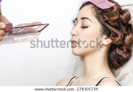 beautiful young asian lady preparing for make up in the beauty parlor. - stock photo