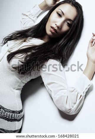 Beautiful young asian model. Studio shot.