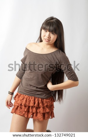 Beautiful young asian model. Torso Studio shot. Cheerful young Asian girl, half length portrait on white background. China student - stock photo