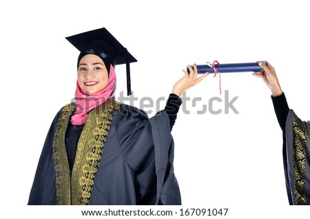 beautiful young asian muslim graduate student stock photo  beautiful young asian muslim graduate student wearing graduation cap and gown holding a diploma certificate