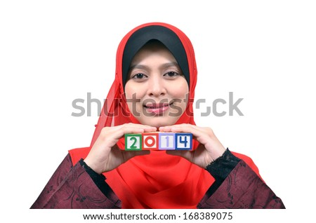 Beautiful young Asian muslim woman happy celebrate New Year 2014 isolated on white background