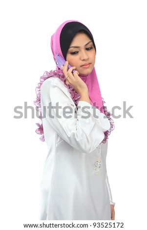 Beautiful young asian muslim woman talk on mobile phone isolated white background - stock photo