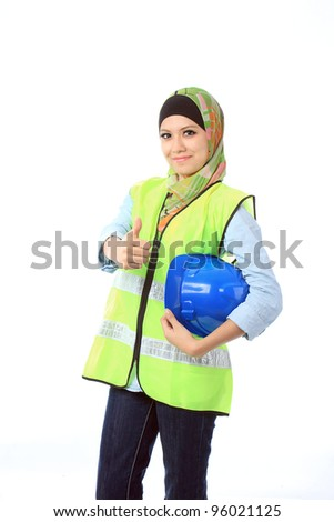 Beautiful young asian muslim woman with personal protective equipment show thumbs up - stock photo