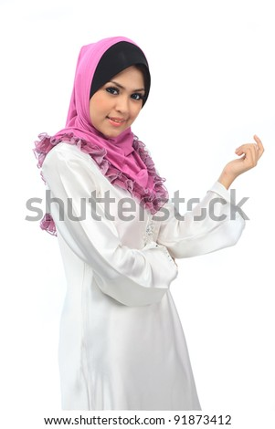 Beautiful young asian muslim woman with warm welcome smile - stock photo