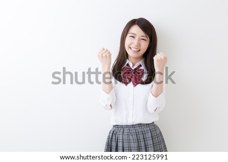 Beautiful young asian school girl - stock photo