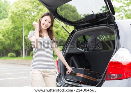 Beautiful young asian woman and car - stock photo
