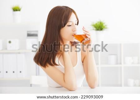 beautiful Young asian woman drinking tea