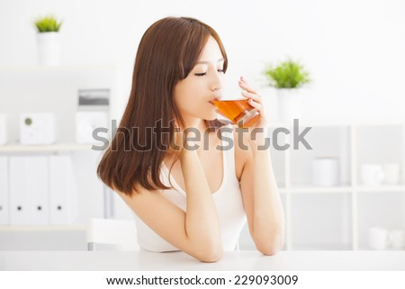 beautiful Young asian woman drinking  tea - stock photo
